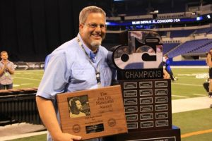 John Meehan celebrates the Blue Devils' 2014 DCI championship and high brass award in August at Lucas Oil Stadium in Indianapolis.